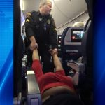 Police literally drag entitled woman off airplane