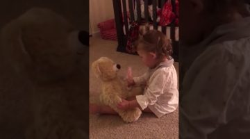 Little girl gets a bear from her deployed Dad, she flips out when she squeezes its hand