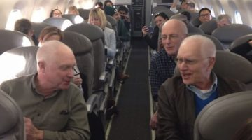 Plane passengers whip out their phones when they notice what a few seniors start doing on the flight
