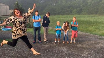 Mom lines up her grumpy kids every year for back to school photos
